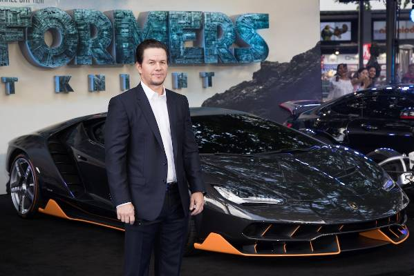 Mark Wahlberg poses with a Lamborghini Centenario at the premiere of Transformers The Last Knight in London