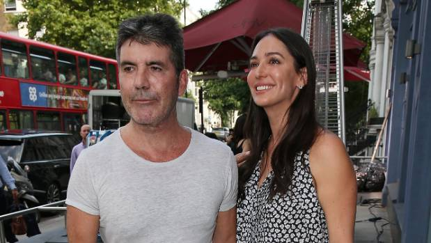 "Simon Cowell and Lauren Silverman seen at Sarm music studio. ""I was going to send a cheque but I thought we could do ..."
