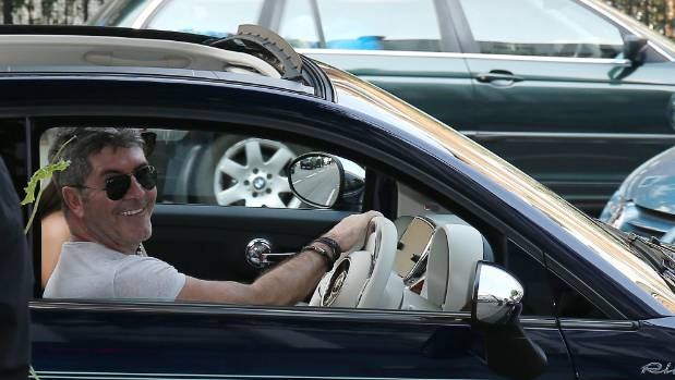 Simon Cowell seen arriving at Sarm music studios, called in some favours in the UK music industry.