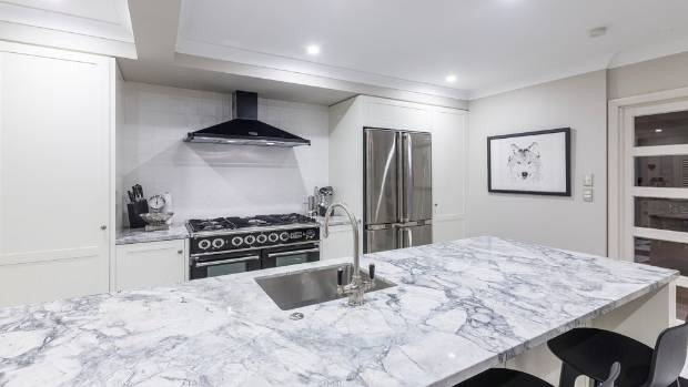 The benchtops are Super White granite, which has a strong grey veining.