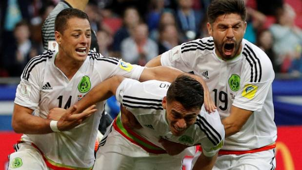 Mexican defender Hector Moreno celebrates his 91st minute equaliser in their tournament opener against Portugal with ...