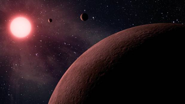 Artist's concept depicts an itsy-bitsy planetary system that is so compact that it's more like Jupiter and its moons ...