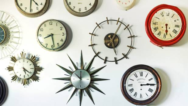 Collection of clocks, all set to different times.
