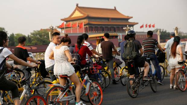 Young Chinese have embraced the sharing economy, like renting bikes.