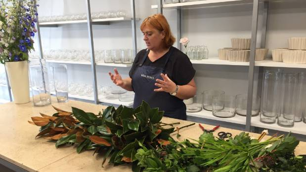 Davina Prankerd teaches a beginners flower arrangement class.