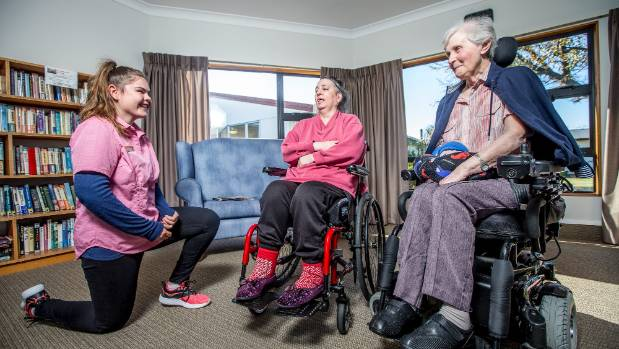 Maddi Duley, 18, chats to rest home residents Katherine Bruning, left, and Noeline Harvey.