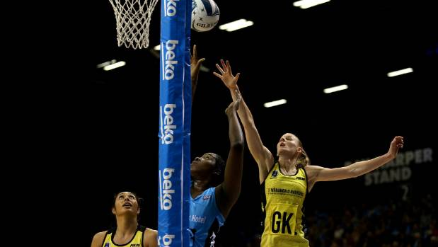 Southern Steel netball shooter Jhaniele Fowler-Reid shoots despite the attention of Central Pulse defenders Phoenix ...