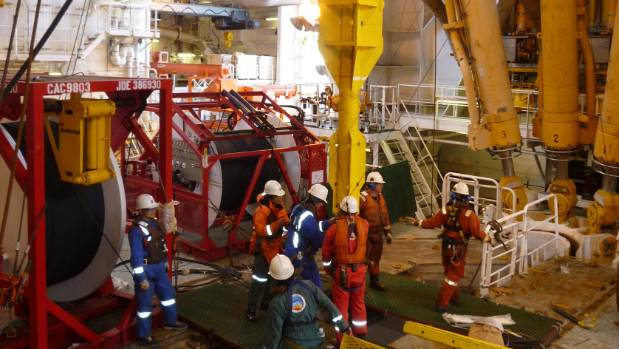 Researchers prepare a wellhead as part of the monitoring of the Nankai Trough.