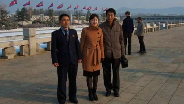A photo New Zealander Nick Calder took while on holiday of his tour guides in Pyongyang, North Korea.
