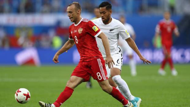 All Whites midfielder Bill Tuiloma pushes up to apply pressure on Russian counterpart Dennis Glushakov in the opening ...