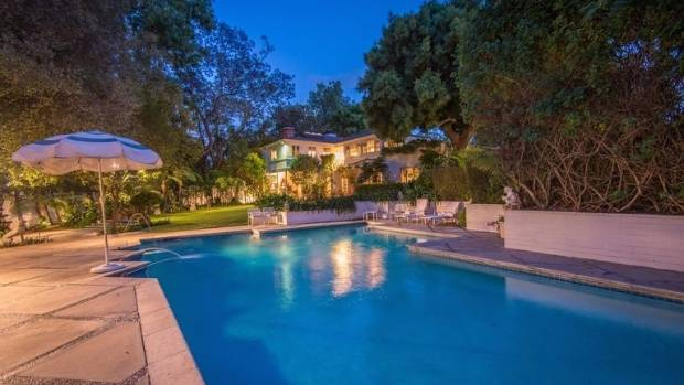 The property's large backyard features a large pool.