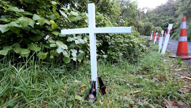 A memorial cross for Shawn Cameron Bartlett, 31, who died after rolling his truck near Portage.