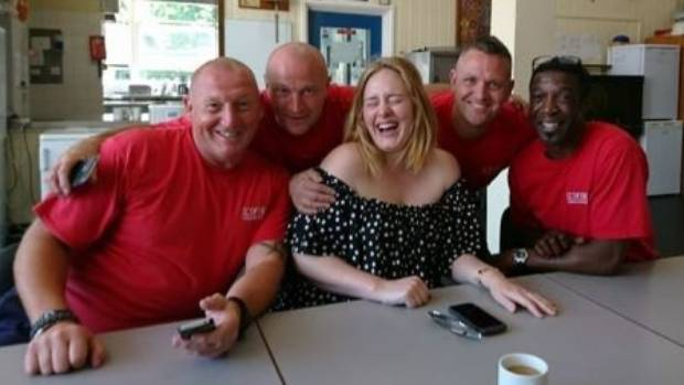 Spreading good cheer... Adele visits the London tower firefighters.
