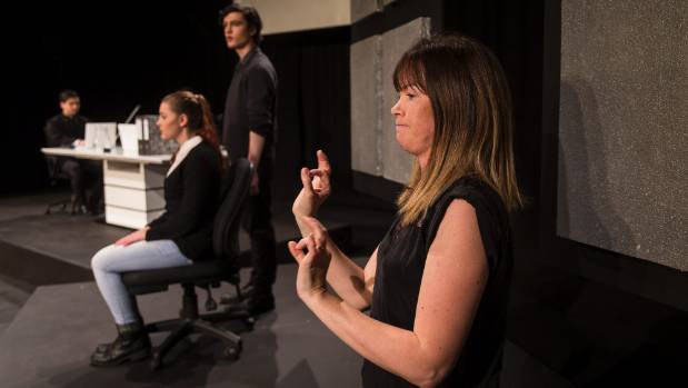 Interpreter Liz Kay rehearses ahead of her performance for the deaf community on Wednesday.
