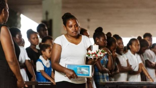 Mourners at the funeral service for Dalzinia Kioniau who drowned after spending hours in the water.