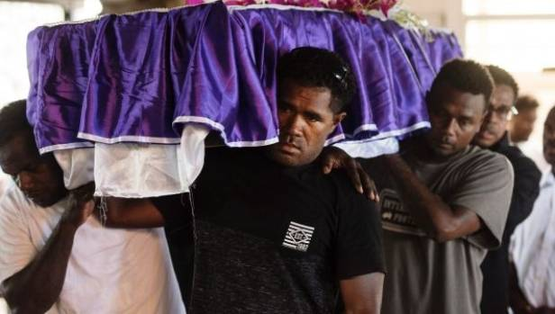 Pallbearers at Holy Cross Cathedral in Honiara.