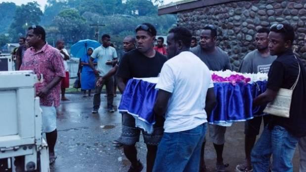 Pallbearers carry the coffin of Dalzinia Kioniau.