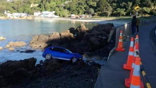 The towing company has its work cut out to remove RUINED from the rocks.
