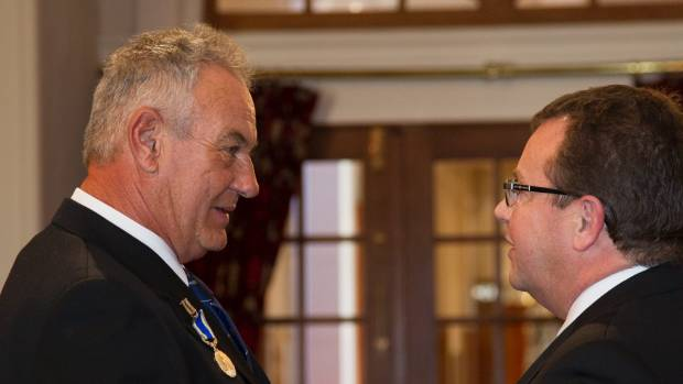 Murray Michie, left, receives the Stanhope gold medal from Michael Webster, clerk of the executive council, for his ...