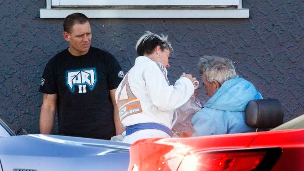Proprietors of The Fight Shop in Palmerston North offer assistance to a man who was assaulted and knocked out of his ...