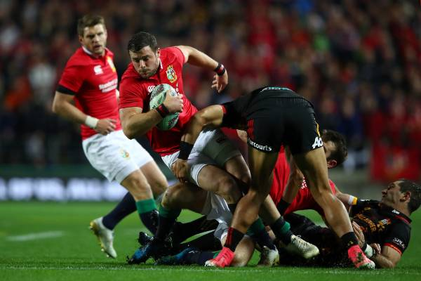 Robbie Henshaw of the Lions is stopped by the Chiefs defence.