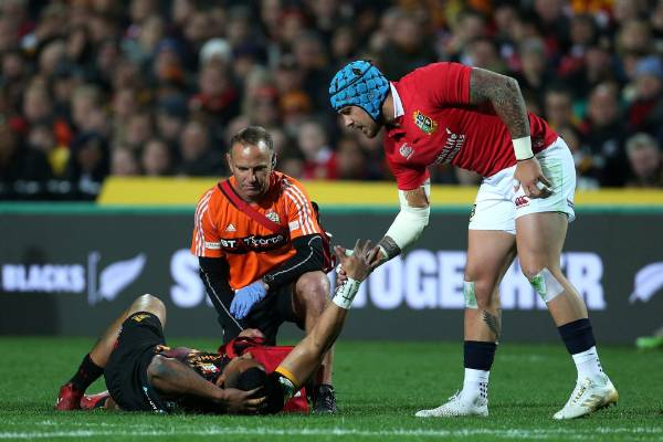 Lions wing Jack Nowell checks on injured Chiefs wing Toni Pulu.