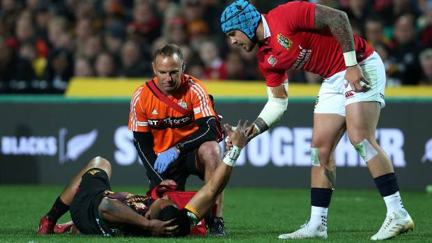 Lions winger Jack Nowell offers a consoling handshake to injured Chiefs winger Toni Pulu.