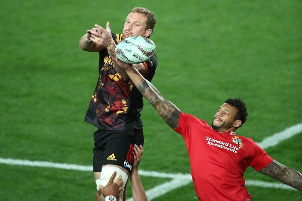 Courtney Lawes of the Lions and Dominic Bird of the Chiefs contest the ball in the lineout.