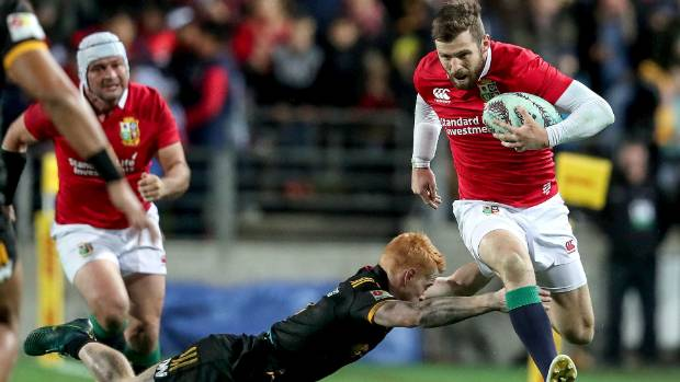 Lions winger Elliot Daly tries to evade the tackle of Finlay Christie for the Chiefs.