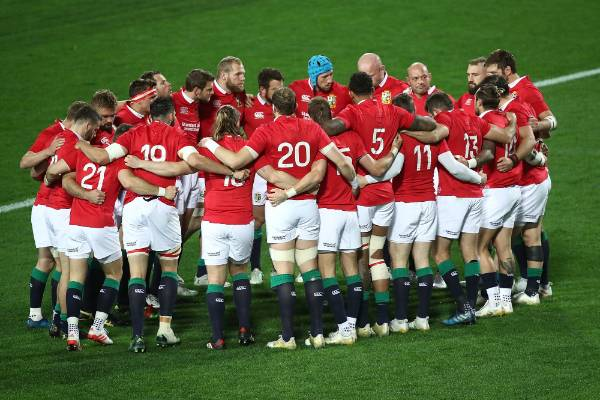The Lions huddle together before the match.