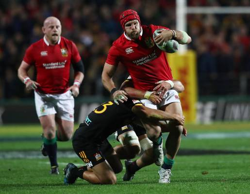 James Haskell of the Lions is tackled by the Chiefs' Chase Tiatia.