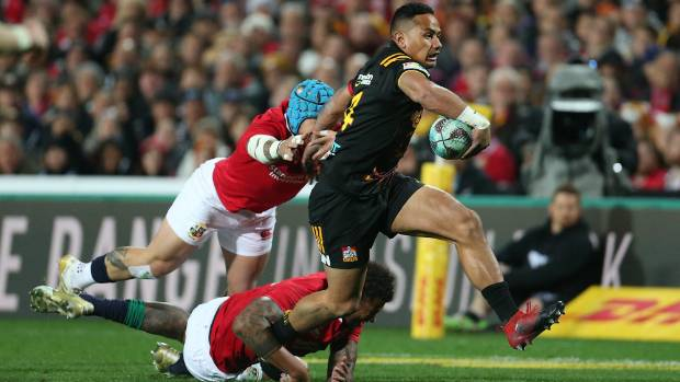 Chiefs winger Toni Pulu attacks just moments before being stretchered off FMG Stadium Waikato.