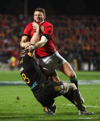 Lions first five-eighth Dan Biggar tackles Tom Sanders of the Chiefs.