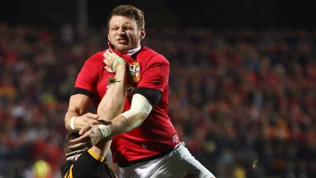 Lions pivot Dan Biggar is tackled by Chiefs loose forward Tom Sanders.