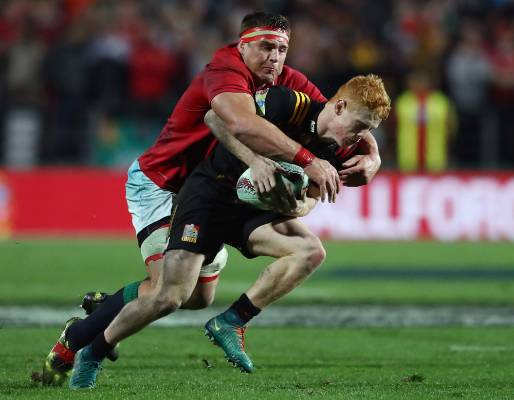 Chiefs halfback Finlay Christie is hauled down by CJ Stander.