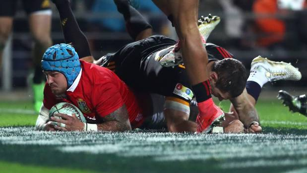 Jack Nowell of the Lions goes over to score his team's second try.