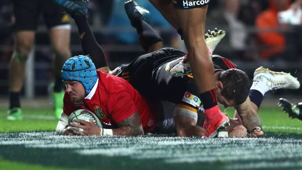 Jack Nowell touches down for one of the four Lions tries against the Chiefs.