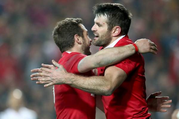 Jared Payne of the Lions is congratulated on his try by Robbie Henshaw.