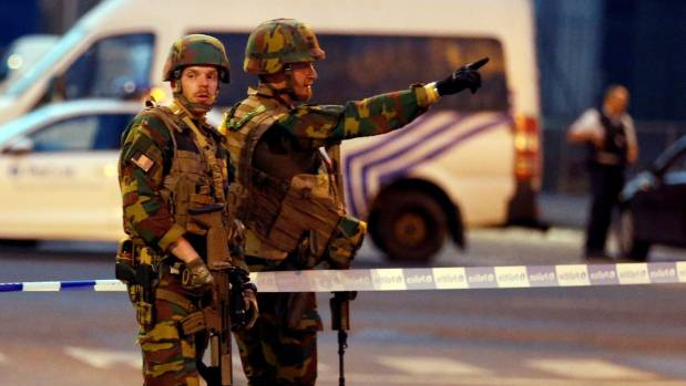 Belgian troops stand guard around Central Station in Brussels following an explosion.