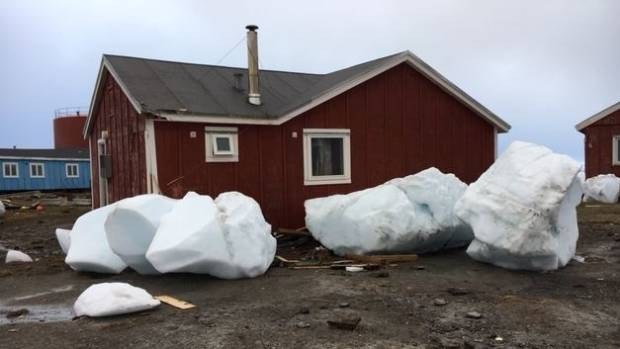 Large chunks of ice appear to have been swept into a Greenland village by the tsunami in June.