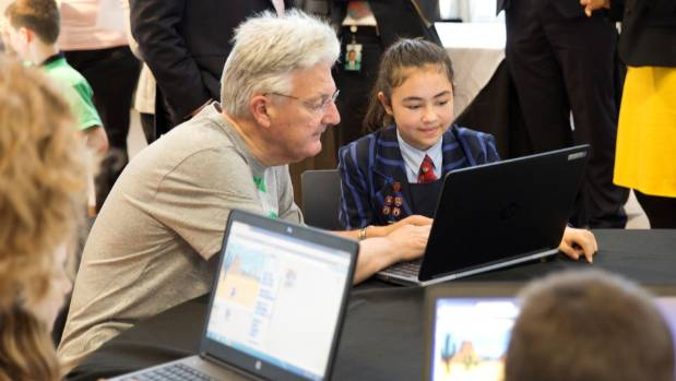 Amelia Lockley, 12, teaches Internal Affairs Minister Peter Dunne coding at the Beehive in Wellington last month.