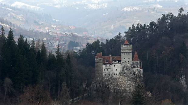 "Bran Castle, famous as ""Dracula's Castle,"" stands among Transylvanian mountains .. Bran Castle's reputation as the ..."
