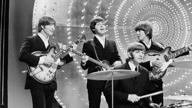 The Beatles perform 'Rain' and 'Paperback Writer' on BBC TV show 'Top Of The Pops' in London on 16th June 1966. Left to ...