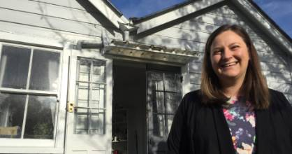 First home buyer Jessie Pottinger stands outside her house in Featherston