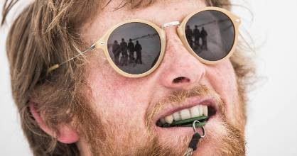 Waikaia River's Taylor Hill, with his mates reflected in his glasses, at the Monteith's Dog Derby at Coronet Peak ski ...