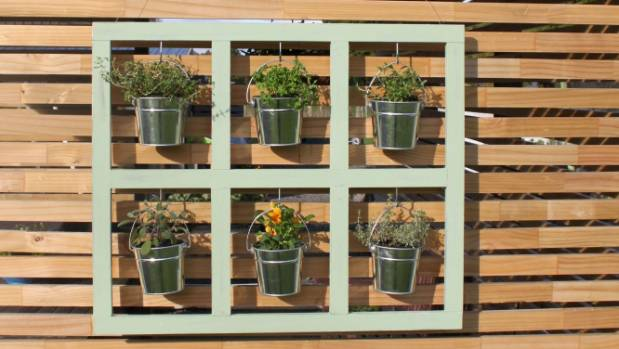 Place herb or plant pots into the buckets and hang  indoors or out.