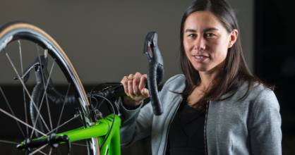 Andrea Hewitt with the competition bike she rode at the Rio Olympics that was auctioned to launch her AH Foundation.