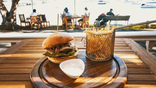 Patrons would usually enjoy the Governor's Burger, served with hot chips and aioli, on the deck overlooking the Bay of ...