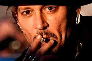 Actor Johnny Depp joked about assassinating a president at the UK's Glastonbury Festival.