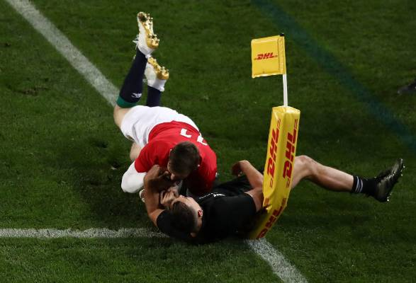 Elliot Daly of the Lions is tackled short of the tryline by Israel Dagg.